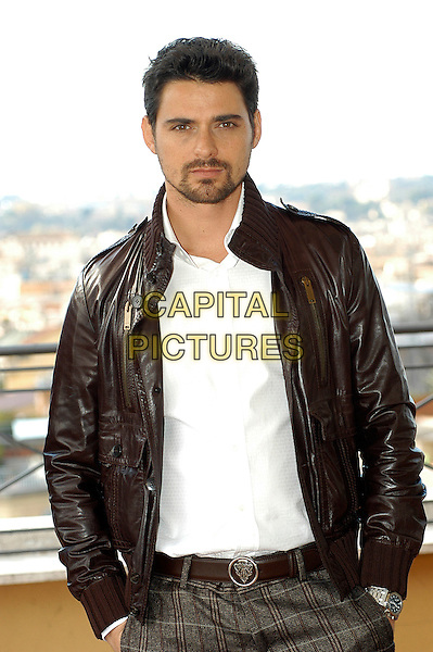 """SIMONE CORRENTE.Photocall for """"Milano-Palermo: il ritorno"""", Rome, Italy..November 15th, 2007.half length brown leather jacket hands in pockets goatee facial hair .CAP/CAV.©Luca Cavallari/Capital Pictures."""
