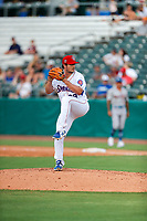 Tennessee Smokies pitcher Garrett Kelly (28) delivers a pitch to the plate against the Rocket City Trash Pandas at Smokies Stadium on July 2, 2021, in Kodak, Tennessee. (Danny Parker/Four Seam Images)