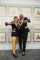 Martin Desmond Roe and Travon Free pose backstage with the Oscar® for Live Action Short during the live ABC Telecast of The 93rd Oscars® at Union Station in Los Angeles, CA on Sunday, April 25, 2021.<br /> *Editorial Use Only*<br /> ©A.M.P.A.S.<br /> Image supplied by Capital Pictures