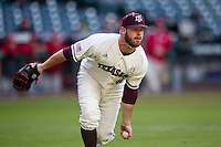 Texas A&M Aggies pitcher A.J. Minter (34) toss the ball to first base during Houston College Classic against the Nebraska Cornhuskers on March 6, 2015 at Minute Maid Park in Houston, Texas. Texas A&M defeated Nebraska 2-1. (Andrew Woolley/Four Seam Images)