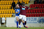 Hearts v St Johnstone...14.02.12.. Scottish Cup 5th Round Replay.David Obua holds off Frazer Wright.Picture by Graeme Hart..Copyright Perthshire Picture Agency.Tel: 01738 623350  Mobile: 07990 594431