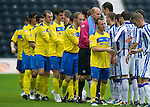 Kilmarnock v St Johnstone...01.10.11   SPL Week 10.Jody Morris leads the St Johnstone players as they shake hand with the Kilmarnock players before kick off.Picture by Graeme Hart..Copyright Perthshire Picture Agency.Tel: 01738 623350  Mobile: 07990 594431