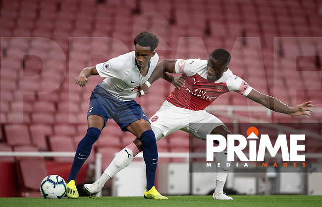 Tashan Oakley-Boothe of Tottenham Hotspur & Joseph Olowu of Arsenal during the Premier League 2 match between Arsenal U23 and Tottenham Hotspur U23 at the Emirates Stadium, London, England on 31 August 2018. Photo by Andy Rowland.