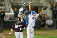 UCLA pitcher David Berg (26) celebrates the final out as Mississippi State Bulldog runner Matthew Britton (15) sprints to first base at the 2013 Men's College World Series Final on June 25, 2013 at TD Ameritrade Park in Omaha, Nebraska. The Bruins defeated the Bulldogs 8-0, winning the National Championship. (Andrew Woolley/Four Seam Images)