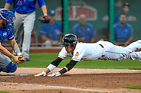 Angel Rosa (6) of the Salt Lake Bees dives for the plate against the Round Rock Express in Pacific Coast League action at Smith's Ballpark on August 13, 2016 in Salt Lake City, Utah. Round Rock defeated Salt Lake 7-3.  (Stephen Smith/Four Seam Images)