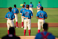 Clearwater Threshers shortstop Edgar Made (2), pitcher Mick Abel (25), and first baseman D.J. Stewart (12) during the national anthem before a game against the Lakeland Flying Tigers on May 5, 2021 at BayCare Ballpark in Clearwater, Florida.  (Mike Janes/Four Seam Images)