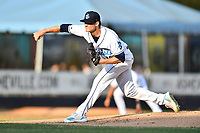 Asheville Tourists starting pitcher Ryan Feltner (14) delivers a pitch during a game against the Charleston RiverDogs at McCormick Field on May 22, 2019 in Asheville, North Carolina. The Tourists defeated the RiverDogs 10-8. (Tony Farlow/Four Seam Images)