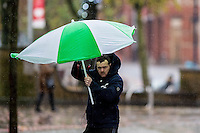 """Monday  21 November 2014<br /> Pictured: A man struggles with an umbrella<br /> Re: A yellow """"be aware"""" weather warning has been issued as widespread heavy rain hits the country. The Met Office said gusts of winds could hit 50mph (80km/h) with localised flooding and disruption to travel."""