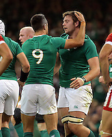 Pictured: Iain Henderson of Ireland (R) celebrates his try with team mate Conor Murray Saturday 19 September 2015<br /> Re: Rugby World Cup 2015, Ireland v Canada at the Millennium, Stadium, Wales, UK