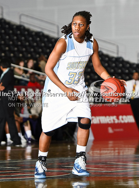 Southern University Jaguars guard Tiffany Foster (33) in action during the SWAC Tournament Championship game between the Prairie View A&M Lady Panthers and the Southern University Jaguars at the Special Events Center in Garland, Texas. Prairie View defeats  Southern 48 to 44