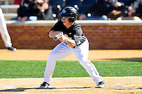 Andrew Williams (16) of the Wake Forest Demon Deacons squares to bunt against the Youngstown State Penguins at Wake Forest Baseball Park on February 24, 2013 in Winston-Salem, North Carolina.  The Demon Deacons defeated the Penguins 6-5.  (Brian Westerholt/Four Seam Images)