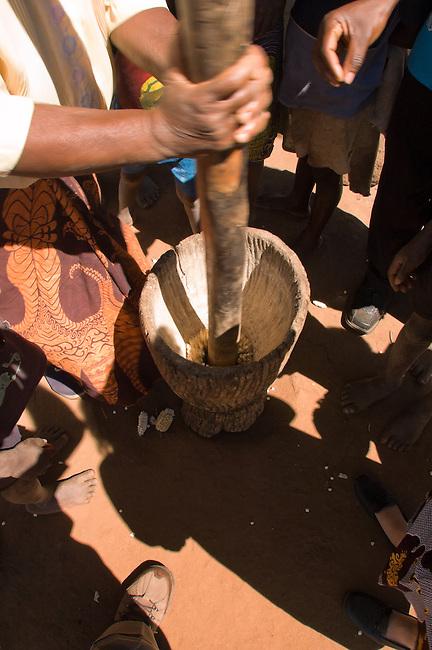 Pounding maize into maize meal