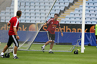 Wednesday 07 August 2013<br /> Pictured: Manager Michael Laudrup (R) pulling the nets with scout Erik Larsen (L) during training at the Malmo Stadium, Sweden.<br /> Re: Swansea City FC travelling to Sweden for their Europa League 3rd Qualifying Round, Second Leg game against Malmo.