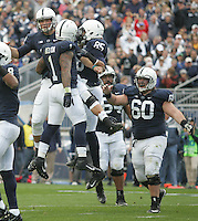 State College, PA - 11/02/2013:  PSU QB Christian Hackenberg (left) celebrates with his teammates after scoring a touchdown on a 9 yard run in the 2nd quarter.  Penn State defeated Illinois by a score of 24-17 in overtime on Saturday, November 2, 2013, at Beaver Stadium.<br /> <br /> Photos by Joe Rokita / JoeRokita.com