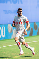 LAKE BUENA VISTA, FL - JULY 13: Alejandro Pozuelo #10 of Toronto FC runs toward the ball during a game between D.C. United and Toronto FC at Wide World of Sports on July 13, 2020 in Lake Buena Vista, Florida.