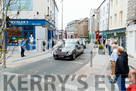A guard of honor at the funeral of Michael Quinlan passing the family fish shop in the Mall, Tralee on Thursday.