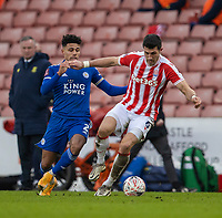 9th January 2021; Bet365 Stadium, Stoke, Staffordshire, England; English FA Cup Football, Carabao Cup, Stoke City versus Leicester City; Danny Batth of Stoke City under pressure from James Justin of Leicester City