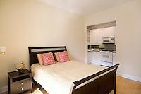 Bedroom with open plan kitchen