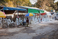 Myanmar, Burma, Mandalay.  Buddha Stone-carving Workshops.  Many are exported to China.