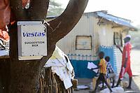 KENYA, Masabit, village Namare at road to Lake Turkana Wind Power Project, Vestas sugestion box, Vestas will supply in the next four years wind turbines and rotor blades for the 310 MW project, the largest windfarm in africa / KENIA, Marsabit, Dorf Namare liegt an der Strasse zum Lake Turkana Wind Power Projekt, hier werden in den naechsten 4 Jahren Wind Turbinen und Rotorblaetter des Herstellers Vestas zur Baustelle des 310 MW Projektes entlang rollen, VESTAS Briefkasten fuer Empfehlungen