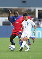 Judelin Aveska (8) and Roger Espinoza (23) battle for the ball. Honduras defeated Haiti 1-0 during the First Round of the 2009 CONCACAF Gold Cup at Qwest Field in Seattle, Washington on July 4, 2009.