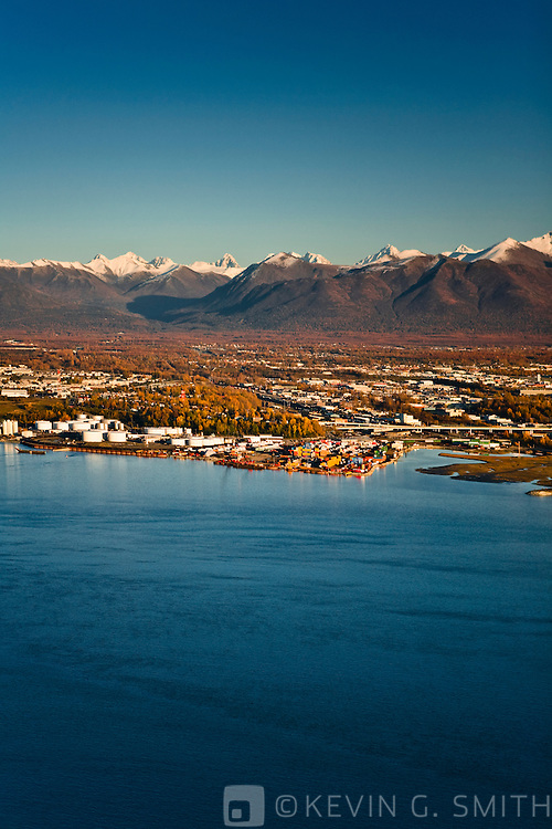 Aerial view of Anchorage small boat harbor, looking to the east  with the Chugach Mountain Range behind it, fall foliage, sunset, Anchorage, Alaska, USA.