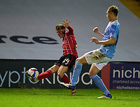 Lincoln City's Robbie Gotts crosses under pressure from Manchester City U21's Callum Doyle<br /> <br /> Photographer Andrew Vaughan/CameraSport<br /> <br /> EFL Papa John's Trophy - Northern Section - Group E - Lincoln City v Manchester City U21 - Tuesday 17th November 2020 - LNER Stadium - Lincoln<br />  <br /> World Copyright © 2020 CameraSport. All rights reserved. 43 Linden Ave. Countesthorpe. Leicester. England. LE8 5PG - Tel: +44 (0) 116 277 4147 - admin@camerasport.com - www.camerasport.com