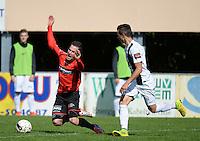 Winkel Sport - SK Deinze  : Benjamin Lutun (links) gaat opzichtig neer na licht contact met Jarric Buysse (r) <br /> foto VDB / BART VANDENBROUCKE