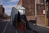 April 12, 2020<br /> Brooklyn, New York<br /> <br /> The Brooklyn Hospital Center in Fort Greene is an intake for coronavirus patients in Brooklyn. The entrance ramp for one of two add on cooled containers being used as a morgue for coronavirus deceased.