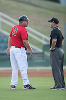Kannapolis Intimidators manager Tommy Thompson (39) argues a call with base umpire Grant Conrad during the game against the Asheville Tourists at Intimidators Stadium on June 25, 2015 in Kannapolis, North Carolina.  The Intimidators defeated the Tourists 9-8.  (Brian Westerholt/Four Seam Images)