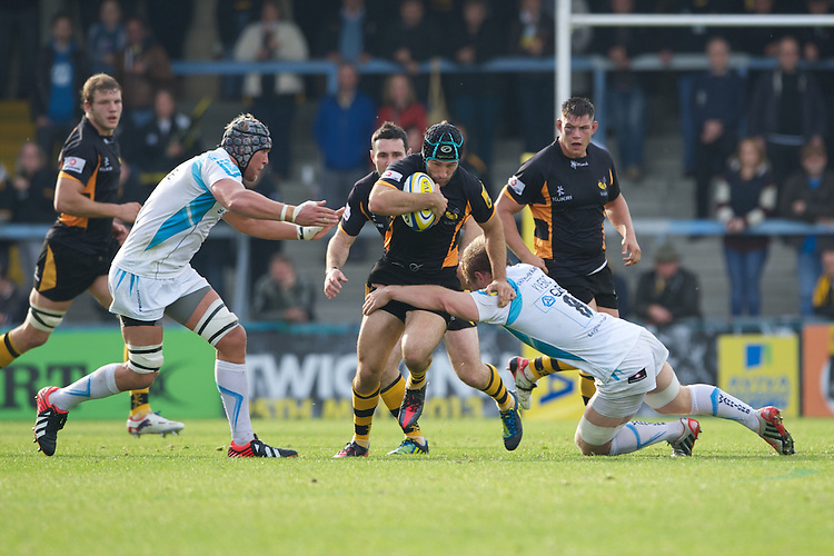 Chris Bell of London Wasps is tackled by Matt Kvesic of Worcester Warriors during the Aviva Premiership match between London Wasps and Worcester Warriors at Adams Park on Sunday 7th October 2012 (Photo by Rob Munro)