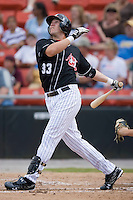 Miles Durham (33) of the Hickory Crawdads follows through on his swing versus the Charleston RiverDogs at L.P. Frans Stadium in Hickory, NC, Sunday, May 4, 2008.