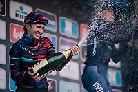 Alexis Ryan (USA/Canyon-SRAM) spraying sweetness over the podium after finishing 2nd<br /> <br /> Omloop Het Nieuwsblad 2018<br /> Gent › Meerbeke: 196km (BELGIUM)