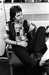 """Paul and Linda McCartney Wings Tour  1975. Paul in rehearsal dressing room, Elstree London England. The photographs from this set were taken in 1975. I was on tour with them for a children's """"Fact Book"""". This book was called, The Facts about a Pop Group Featuring Wings. Introduced by Paul McCartney, published by G.Whizzard. They had recently recorded albums, Wildlife, Red Rose Speedway, Band on the Run and Venus and Mars. I believe it was the English leg of Wings Over the World tour. But as I recall they were promoting,  Band on the Run and Venus and Mars in particular."""