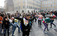 Ballerini si esibiscono durante un flash-mob per protestare contro i tagli alla cultura e allo spettacolo, di fronte a Montecitorio, Roma, 23 marzo 2011..Dancers perform during a flash mob to protest against cuts to entertainment and culture, in front of the Lower Chamber, Rome, 23 march 2011. .UPDATE IMAGES PRESS/Riccardo De Luca