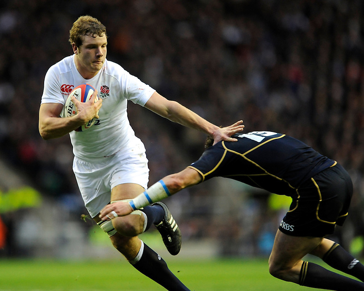 Joe Launchbury of England hands off Sean Lamont of Scotland during the RBS 6 Nations match between England and Scotland at Twickenham on Saturday 02 February 2013 (Photo by Rob Munro)
