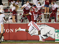 Arkansas wide receiver Treylon Burks (16) scores, Saturday, November 7, 2020 during the third quarter of a football game at Donald W. Reynolds Razorback Stadium in Fayetteville. Check out nwaonline.com/201108Daily/ for today's photo gallery. <br /> (NWA Democrat-Gazette/Charlie Kaijo)