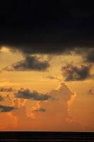 Sunrise in a cloudy sky over the sea, Maldives.