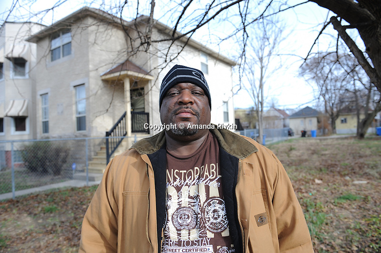 Marvin Reeves, 56, stands in front of the house he bought for his daughter in the Greater Grand Crossing neighborhood in Chicago, Illinois on November 29, 2015.  Reeves purchased and renovated the house with money he received in settlement from the City of Chicago after a codefendant, Ronald Kitchen, and he were both tortured and Kitchen confessed to a crime both were innocent of; Reeves spent 21 years incarcerated from 1988-2009 for a South Side arson that killed two women and three children and had received five consecutive life sentences.