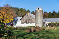 Barn and farm with sbales of hay, Woodstock, Vermont.
