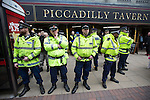 """© Joel Goodman - 07973 332324 . 28/03/2015 . Manchester , UK . Police surround the Piccadilly Tavern where the demonstrators drank inside . Approximately 100 neo-Nazis gather in Manchester for """" White Pride Worldwide day """" . Photo credit : Joel Goodman"""