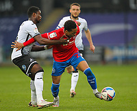 20th April 2021; Liberty Stadium, Swansea, Glamorgan, Wales; English Football League Championship Football, Swansea City versus Queens Park Rangers; Chris Willock of Queens Park Rangers and Marc Guehi of Swansea City jostle for possession