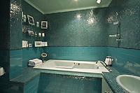 Beautiful Aqua and Teal tiled bath room Stock photo of master bath, en suite, bathroom