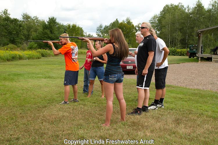 Teenagers shooting rifles