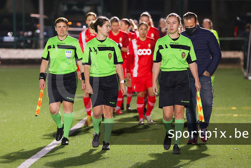 Assistant referee Ella De Vries, match referee Irmgard Van Meirvenne and assistant referee Shauni Depruyst walk towards the match ball before a female soccer game between Oud Heverlee Leuven and Standard Femina De Liege on the 10th matchday of the 2020 - 2021 season of Belgian Womens Super League , sunday 20 th of December 2020  in Heverlee , Belgium . PHOTO SPORTPIX.BE | SPP | SEVIL OKTEM