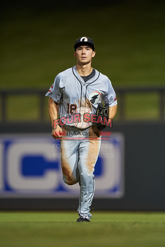 Glendale Desert Dogs right fielder Stuart Fairchild (18), of the Cincinnati Reds organization, jogs off the field between innings of an Arizona Fall League game against the Scottsdale Scorpions on September 20, 2019 at Salt River Fields at Talking Stick in Scottsdale, Arizona. Scottsdale defeated Glendale 3-2. (Zachary Lucy/Four Seam Images)