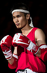 Yang Wen He (Red) of Taiwan enters to the ring prior the male muay 48KG division weight bout against fights against Yiu Tat Fai (Not in picture) of Hong Kong during the East Asian Muaythai Championships 2017 at the Queen Elizabeth Stadium on 13 August 2017, in Hong Kong, China. Photo by Yu Chun Christopher Wong / Power Sport Images