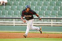 Cleuluis Rondon (13) of the Kannapolis Intimidators takes his lead off of first base against the Lakewood BlueClaws at CMC-Northeast Stadium on August 13, 2013 in Kannapolis, North Carolina.  The Intimidators defeated the BlueClaws 12-8.  (Brian Westerholt/Four Seam Images)