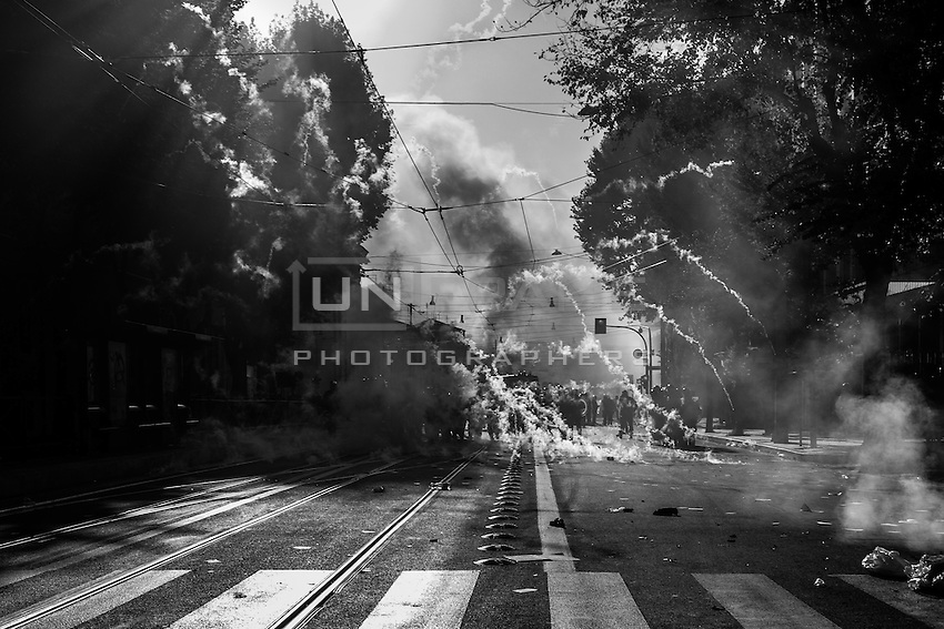 Riot Police fires tear gas canisters in via Labicana against the  rioters during the urban guerilla triggered by violent fringes. Rome, Italy. 15/10/2011