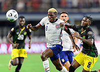 DALLAS, TX - JULY 25: Gyasi Zardes #9 of the United States and Oniel Fisher #8 of Jamaica chase after a loose ball during a game between Jamaica and USMNT at AT&T Stadium on July 25, 2021 in Dallas, Texas.